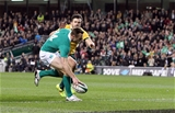 Tommy Bowe goes over for a try despite the efforts of Adam Ashley-Cooper