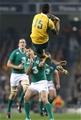Israel Folau rises for a high ball ahead of Rob Kearney
