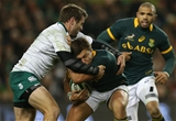 Handre Pollard of SA is tackled by Jared Payne
