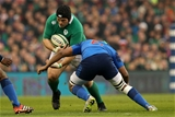 Ireland prop Mike Ross takes the ball into contact, with captain Thierry Dusautoir on defensive duty for France Credit: ©INPHO/Ryan Byrne