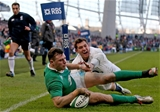 Robbie Henshaw grounds his first try for Ireland despite pressure from England full-back Alex Goode Credit: ©INPHO/Dan Sheridan