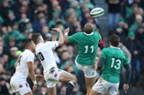 England out-half George Ford and Ireland's Simon Zebo compete for a high ball Credit: ©INPHO/Billy Stickland