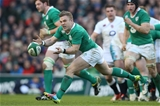 Ireland's replacement out-half Ian Madigan fires a trademark pass away to his left Credit: ©INPHO/Billy Stickland