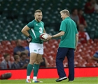 Ian Madigan has a laugh with Joe Schmidt as the players warm up at the home of Welsh rugby Credit: ©INPHO/Billy Stickland