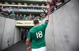 Nathan White heads back towards the dressing room after picking up his first cap for Ireland Credit: ©INPHO/James Crombie