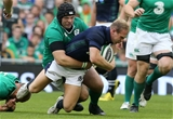 Ireland's ever-present tighthead Mike Ross gets a tackle in on Scottish out-half Greig Tonks Credit: ©INPHO/Billy Stickland