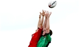 Connacht lock Rita Breen competes in the air with Munster's Elaine Anthony