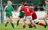 As the rain falls in Galway, Connacht flanker Grainne tests out the tackling of Munster's Amy Desmond and Leah Lyons