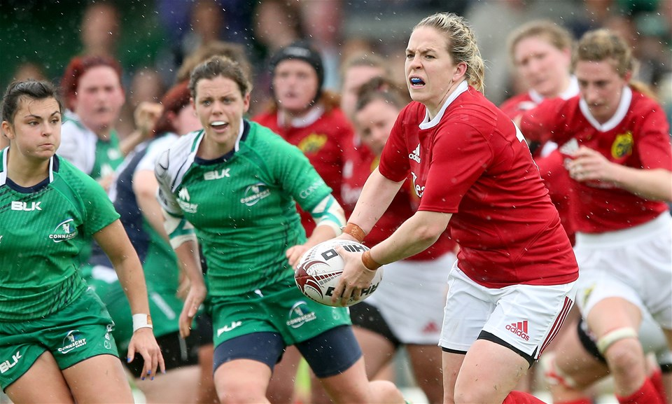 Connacht scrum half Mary Healy is close at hand as Niamh Briggs looks to spread the play for Munster