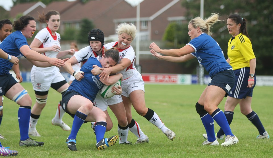 Leinster's Jennie Finlay is tackled by Ulster forwards Imogen Porter and Niamh Fitzgerald