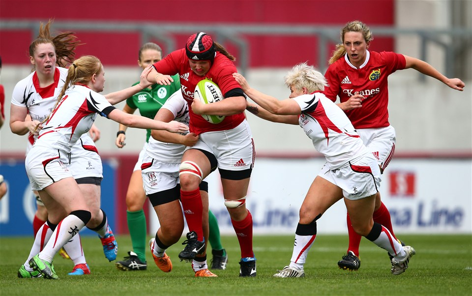 Roisin Ormond, the Munster second row, is closed down by Ulster's Kathryn Dane and Niamh Fitzgerald