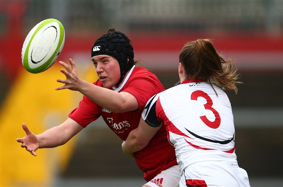 Munster lock Elaine Anthony is tackled by Shannon Heapes as she reaches for possession in Limerick
