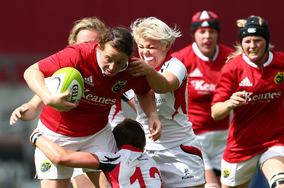 Niamh Kavanagh, one of Munster's try scorers, is put under pressure from Ulster's Claire McLaughlin and Niamh Fitzgerald