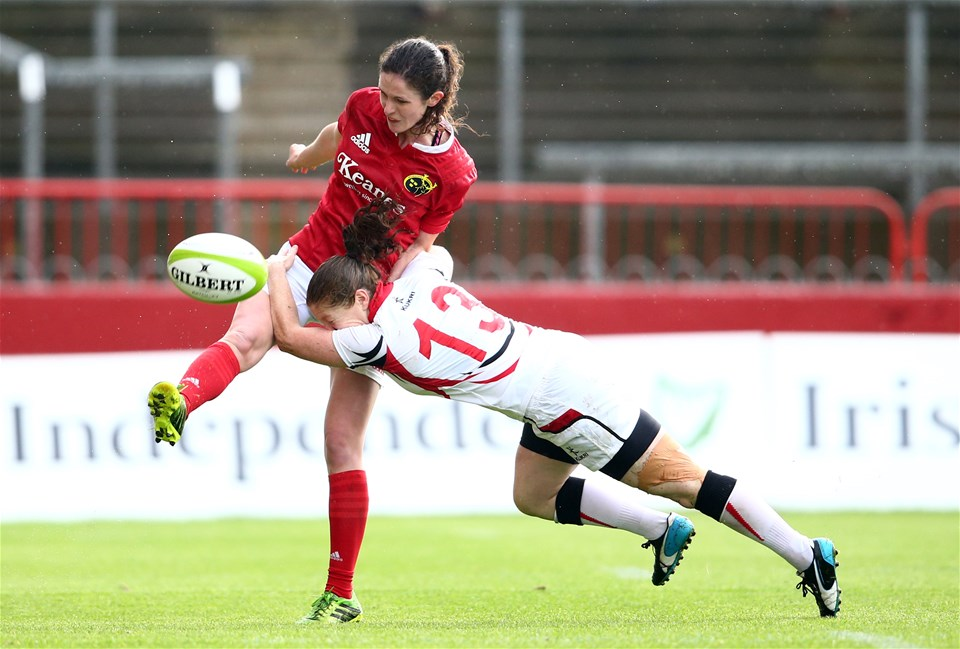 Munster's Valerie Power gets her kick away despite the best efforts of Ulster centre Grace Davitt
