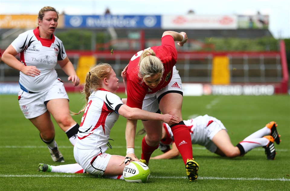 Ulster scrum half Kathryn Dane is unable to prevent Munster captain Niamh Briggs from scoring the game's opening try