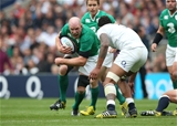 Ireland skipper Paul O'Connell charges towards England lock Courtney Lawes Credit: ©INPHO/Billy Stickland