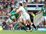 Ireland centre Robbie Henshaw is tackled by England's George Ford and Brad Barritt Credit: ©INPHO/Dan Sheridan