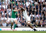 Robbie Henshaw gets his pass away despite the best efforts of England's Courtney Lawes Credit: ©INPHO/Dan Sheridan