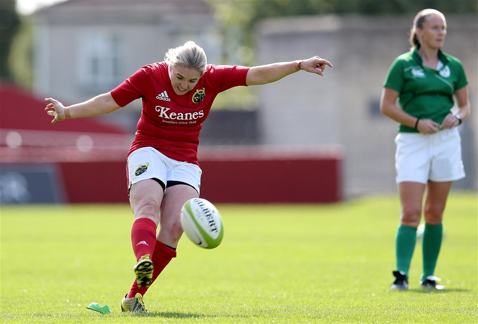 Niamh Briggs aims a kick towards the posts with referee Helen O'Reilly in the backgroun