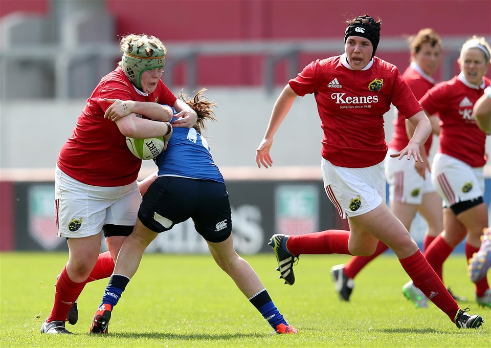 Munster tighthead prop Leah Lyons crashes into a tackle from Leinster's Nora Stapleton