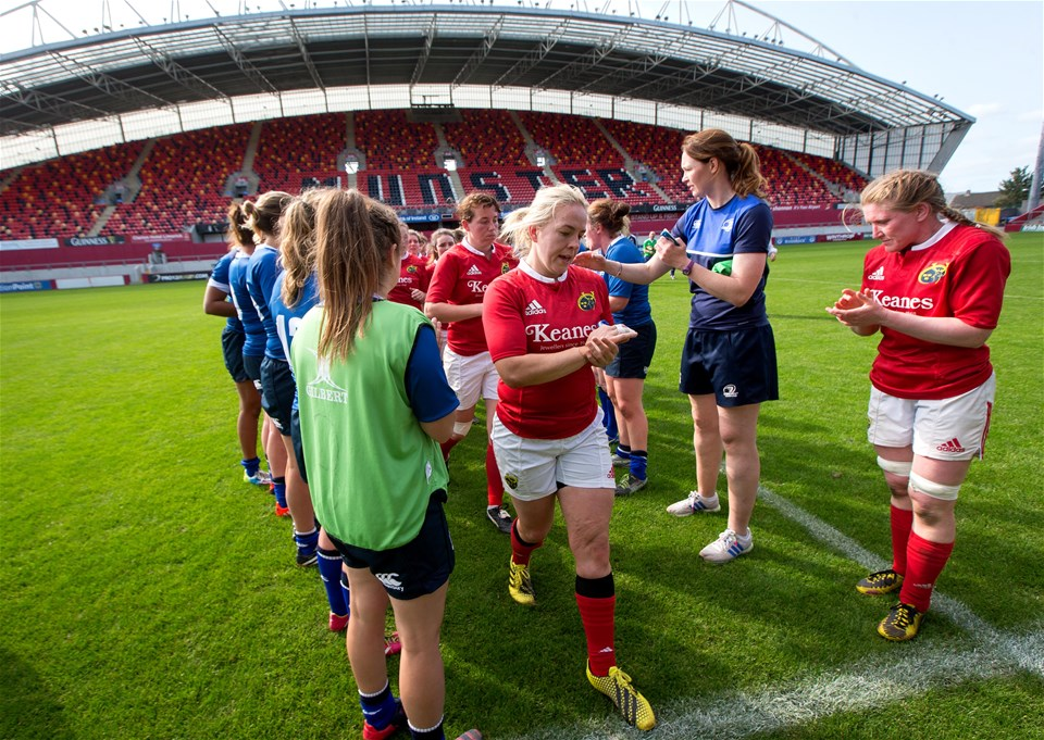 Marie Louise Reilly congratulates her international colleague Niamh Briggs as Leinster clap their Munster counterparts off the pitch