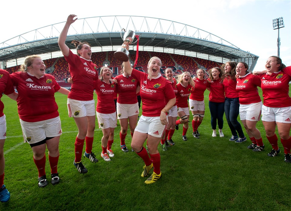 Out-half and captain Niamh Briggs raises the trophy for the victorious Munster side