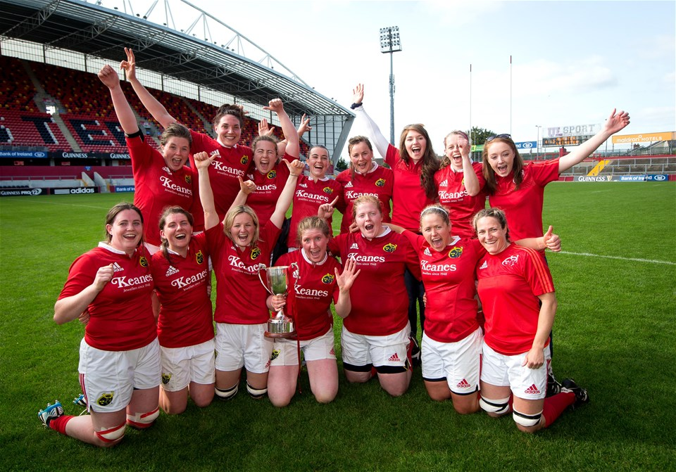 Number 8 Heather O'Brien holds the trophy as Munster's Highfield contingent celebrate their Interpro success in Limerick