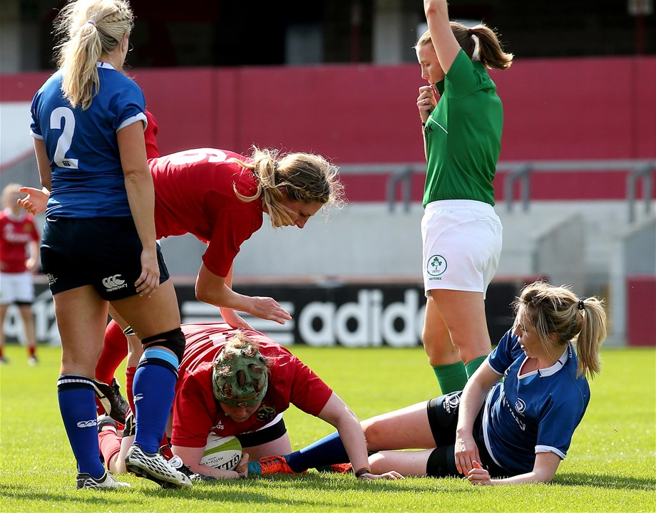 Referee Helen O'Reilly awards the first try of the game which was scored by Munster prop Leah Lyons