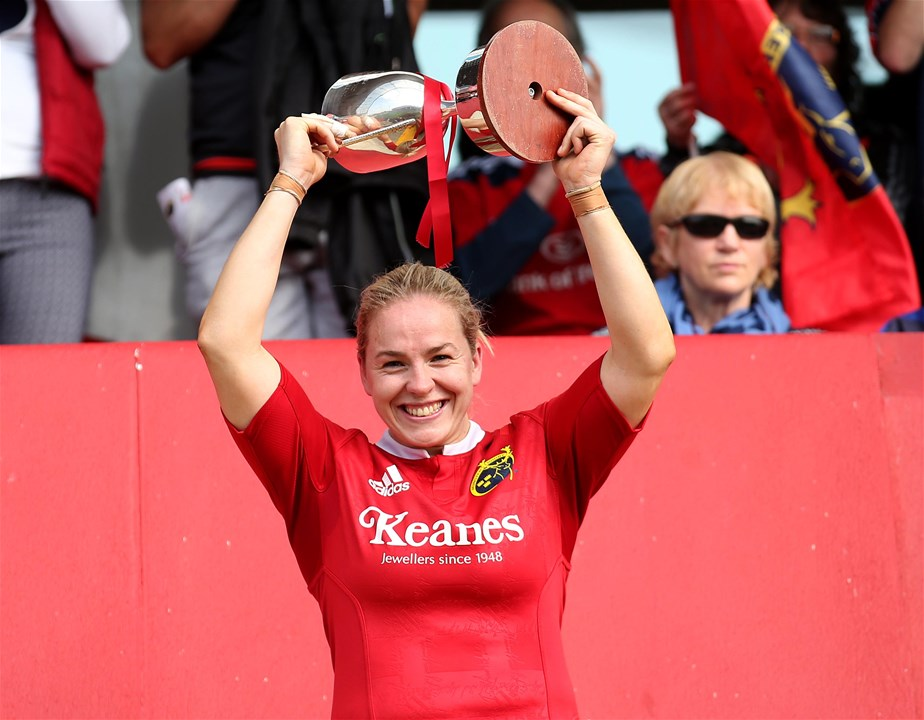 A delighted Niamh Briggs raises the Interpro trophy aloft for champions Munster