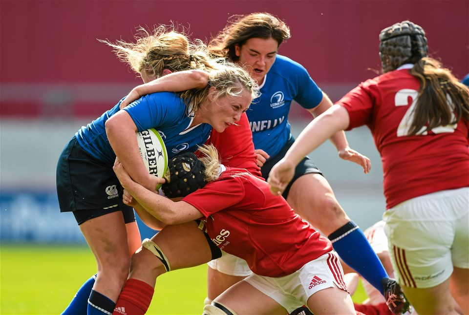 Leinster centre Elise O'Byrne White is sandwiched by two Munster players
