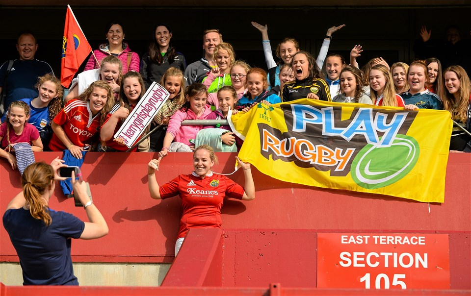 Victorious Munster captain Niamh Briggs is pictured with some of the young fans from the province