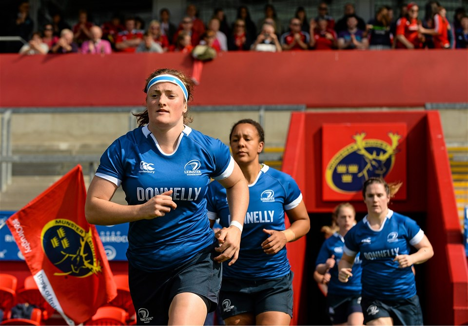 Leinster captain Ailis Egan runs out at Thomond Park, closely followed by World Rugby Women's Player of the Year nominee Sophie Spence