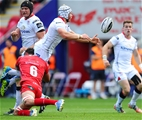 Ulster centre Luke Marshall has the ball knocked loose during a tackle from the Scarlets' man-of-the-match Aaron Shingler Credit: ©INPHO/Craig Thomas