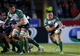 Scrum half John Cooney, one of Connacht's try scorers on the night, releases a pass off the back of a scrum               Credit: ©INPHO/Russell Cheyne