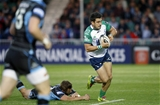 Connacht full-back Tiernan O'Halloran beats the tackle of Glasgow's Fraser Lyle Credit: ©INPHO/Russell Cheyne