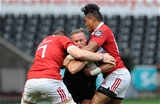 Ospreys winger Hanno Dirksen is sandwiched by Munster's Jack O'Donoghue and Francis Saili Credit: ©INPHO/Ian Cook