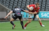 Munster winger Andrew Conway gets away from Kristian Phillips, the Ospreys number 14                    Credit: ©INPHO/Ian Cook