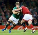 Chris Henry, one of Ireland's second half replacements, crashes into Canada's Aaron Carpenter Credit: ©INPHO/Dan Sheridan