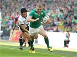 Keith Earls accelerates away from the Romanian defenders to run in Ireland's second try of the afternoon Credit: ©INPHO/Dan Sheridan