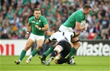 Donnacha Ryan has support from Ian Madigan as he takes on Romanian captain Mihai Macovei Credit: ©INPHO/James Crombie