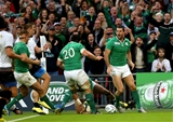 Rob Kearney celebrates scoring Ireland's fifth try with fellow replacement Sean O'Brien Credit: ©INPHO/James Crombie