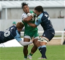 Connacht's bustling centre Bundee Aki feels the force of a double hit from Cardiff duo Rhys Patchell and Ellis Jenkins Credit: ©INPHO/Morgan Treacy