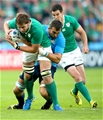 Ireland's man-of-the-match Iain Henderson is tackled by Italian second row Quintin Geldenhuys Credit: ©INPHO/James Crombie