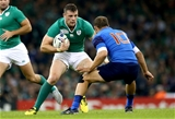 Young centre Robbie Henshaw tries to find a way past French out-half Frederic Michalak Credit: ©INPHO/James Crombie