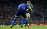 Ian Madigan feels the force of a tackle from French powerhouse Mathieu Bastareaud Credit: ©INPHO/James Crombie