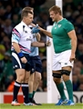 Referee Nigel Owens checks on the health of replacement flanker Chris Henry Credit: ©INPHO/James Crombie