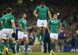 Winger Dave Kearney gets airborne as the Ireland players prepare for kick-off Credit: ©INPHO/Billy Stickland