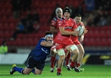 Jamie Davies, who scored the Scarlets' first try, is tackled by Leinster prop Martin Moore Credit: ©INPHO/Simon King