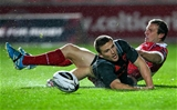 Advancing full-back Andrew Conway managed to touch down for Munster despite the presence of the Scarlets' Hadleigh Parkes Credit: ©SPORTSFILE/Chris Fairweather
