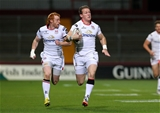 Craig Gilroy is supported by Peter Nelson as he sprints clear to put Ulster 5-0 up Credit: ©INPHO/Ryan Byrne